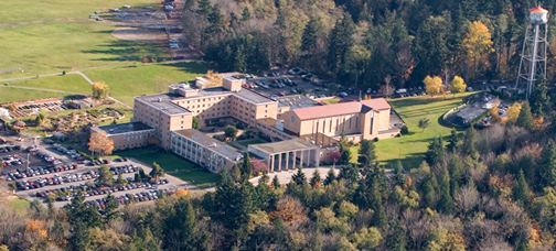 An aerial view of the Bastyr campus taken during the fall.