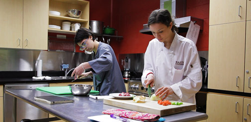 Students prepare a meal in nutrition course.