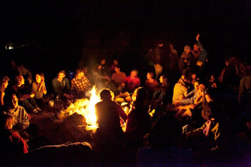 Students around campfire at Revival