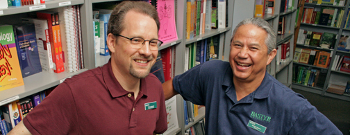 Smiling book store employees.