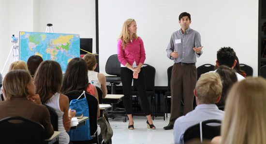 Doctors speak in classroom at open house.