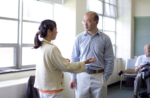 Dr. Sun speaks with a student
