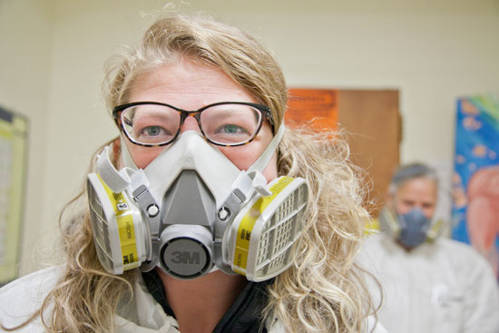 Student Shasta Ward in mask outside of lab.