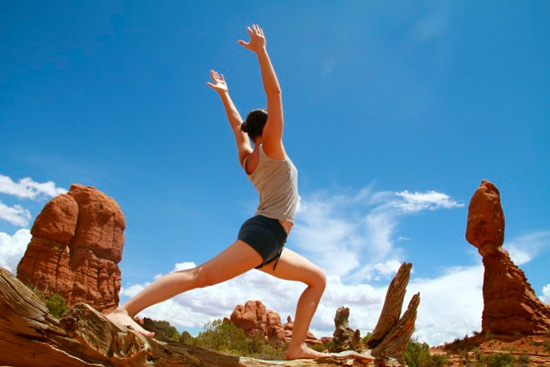 Student Sef Tritt holds yoga pose in Arches National Park
