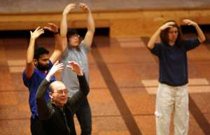 Dr. Sun practices qigong in the Bastyr Chapel.