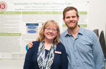 Naomi Lester, PhD, and James McDonald alongside their research poster.