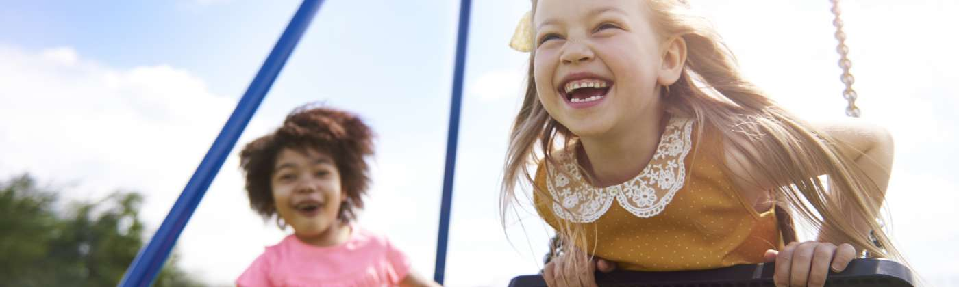 little girls laughing at playground