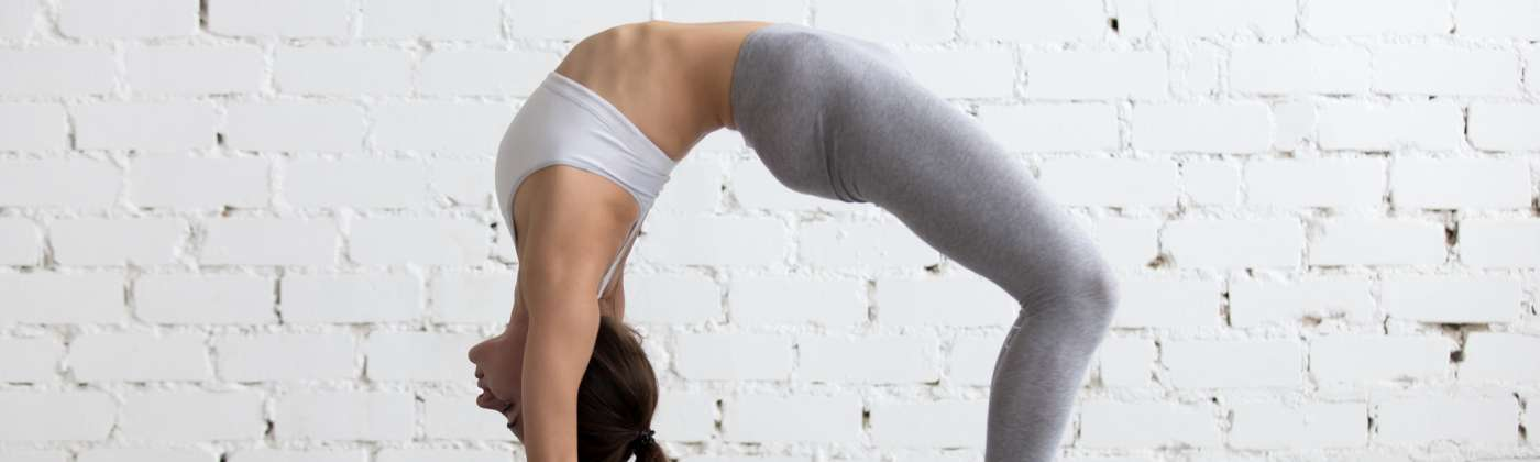 woman in back bend yoga pose