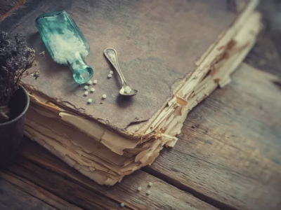 Pill bottle on old book