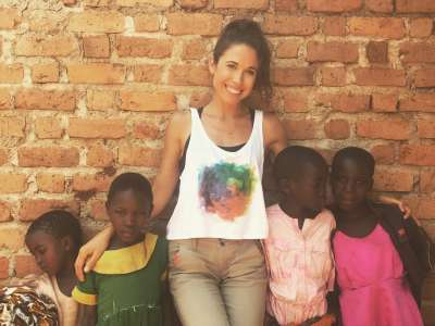 Elly Lieppman in Tanzania with local children