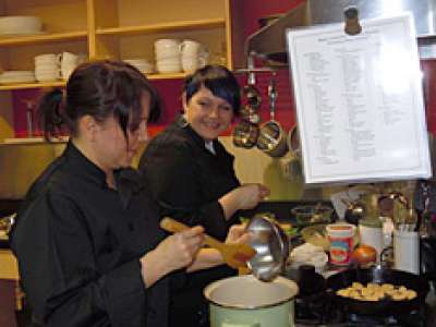 Top Chef winners Sasha and Tina at work in the kitchen.