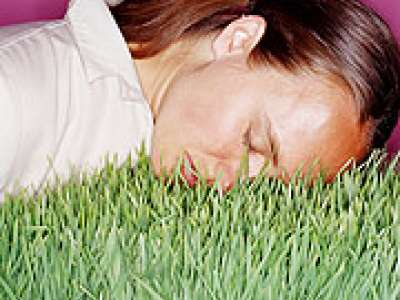 Picture of a woman's face lying on grass