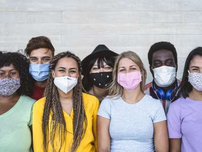 a group of friends wearing masks