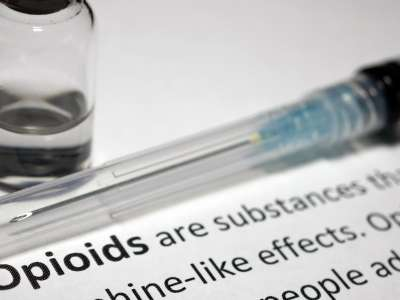 Syringe next to definition of opioids.