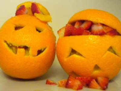 Oranges cut like jack-o'-lanterns
