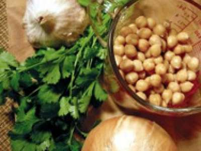 Chickpeas, an onion, cilantro and garlic bulb