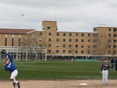 Children playing baseball at Bastyr University Athletic Fields