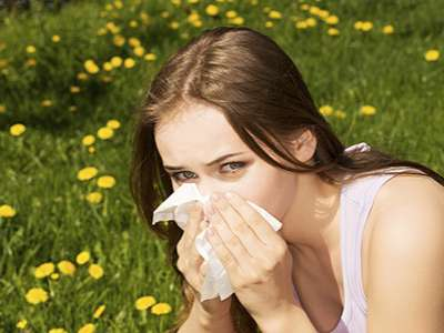 Woman with allergies in a flower field.