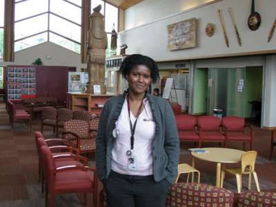 Ravyn Ramos, ARNP, ND ('09), standing in the clinic lobby