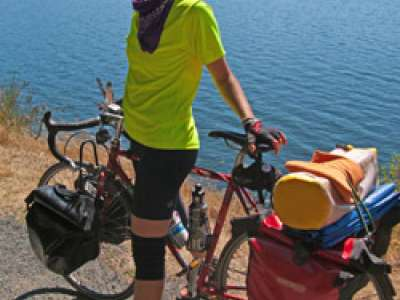 Student with bike along Puget Sound
