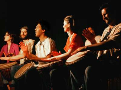 A group of Bastyr students play drums.