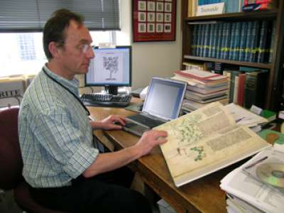 Alain Touwaide, PhD, reading a botanical text at his office.