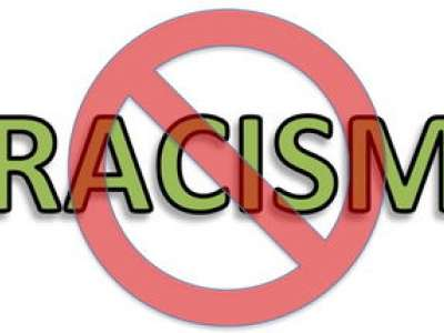 racism word crossed out by red prohibition sign
