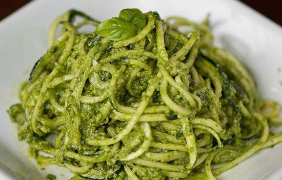 Plate of Raw Zucchini Noodles with Kale Pesto
