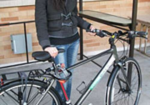 "A student standing with a ""Bastyr Bike"""