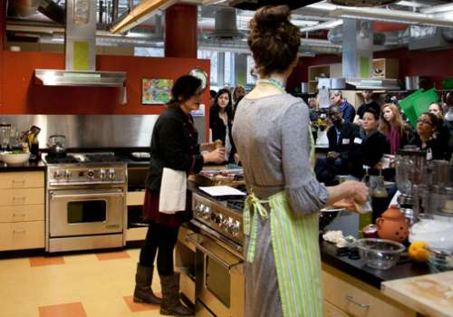 Students doing a cooking demonstration at open house event.