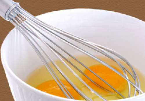 Eggs and a whisk in a bowl