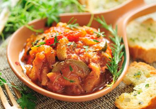 a dish of ratatouille on table