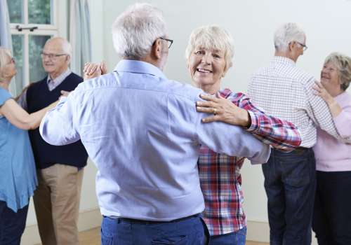 Elderly couples dancing