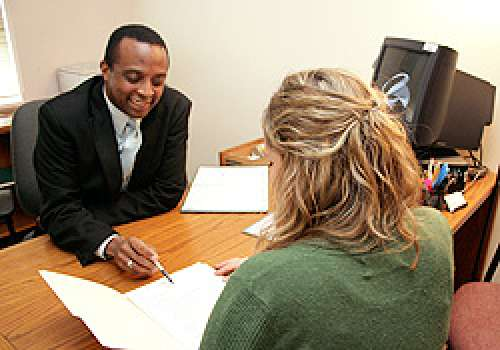 student and career center employee examining a document
