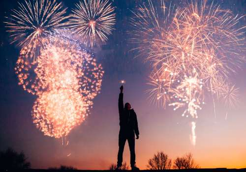 Person standing in front of fireworks