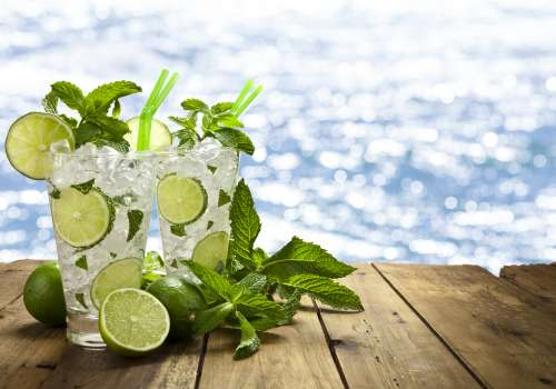 Two cups of water with lime and mint