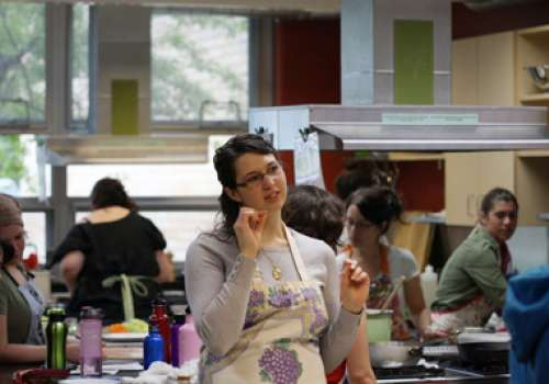 Student in Bastyr's busy whole-food culinary kitchen