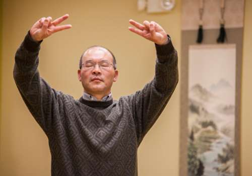 Dr. Sun demonstrates qigong in his Bothell, Washington, practice.
