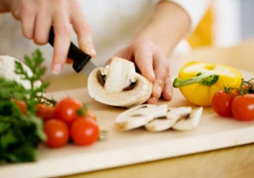 hands cutting vegetables