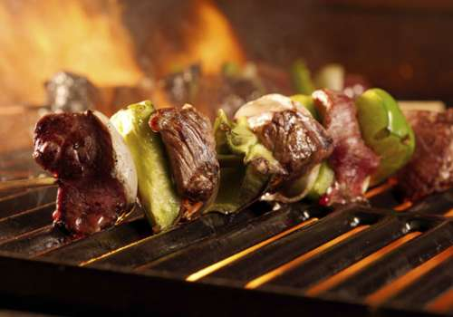 Meat kebabs on grill
