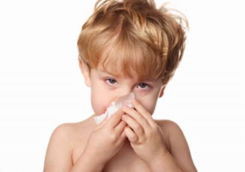 Child blowing his nose.