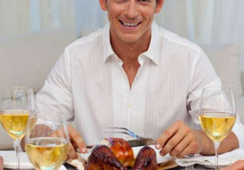 Man sitting in front of a turkey dinner.