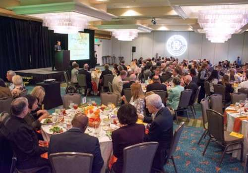 A conference room filled with attendees of Bastyr University Calinfornia's Spring for Health dinner.