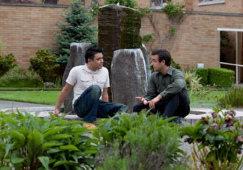 Students conversing in campus courtyard.