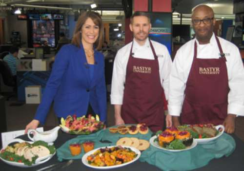 Bastyr University chefs Jim Watkins and Paul Douglas with KOMO/4 anchor Molly Sh