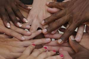 Hands clasped together in cooperation