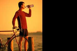 Portrait of bicyclist drinking water