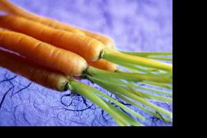 Carrots, the superfood, on a blue table