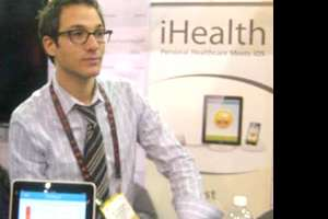 Andrew Brandeis, naturopathic doctor, sitting at his iHealth booth.