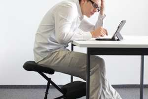 Man slouches at desk
